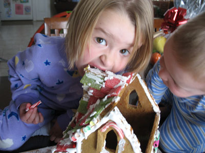 Victorian gingerbread house being eaten