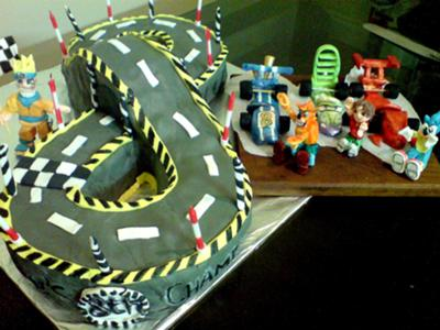 8Th Birthday Cake Ideas http://www.gingerbread-house-heaven.com/my-boys-8th-birthday-racing-track-cake.html